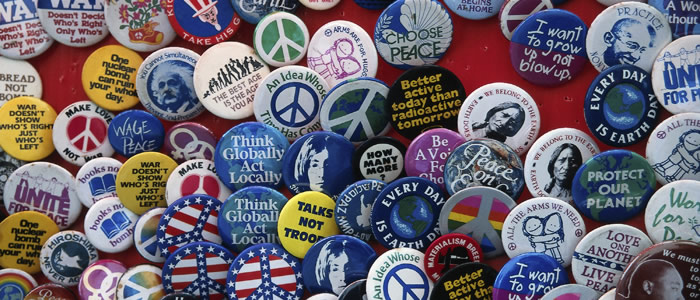 Buttons expressing a variety of social causes, from world peace to environmental concerns.