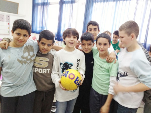 Hillel Day School sixth-grader, Eric Lipsky (center) with pen pals