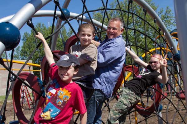 Sunday in the Park, May 26, 2013: Mark Lit, Executive Director of the Jewish Community Center, hangs with young volunteers on site during construction of the playground at the Community Recreation Center at the Oak Park JCC. (Volunteers right to left: Josie Marzorati, Tamir Runinkevich and Joey Winer)
