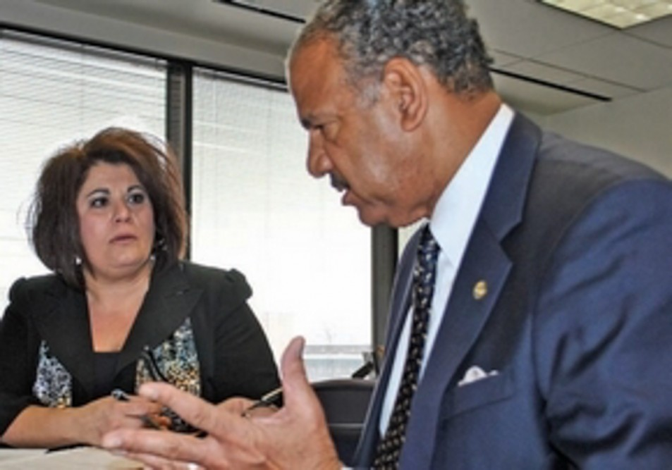 JVS senior HR specialist Laura Panoff discusses a new volunteer training program with Chris Allen, CEO of the Detroit Wayne County Health Authority. The Authority contracts with JVS' HR Solutions Group to handle its HR functions. Photo: Courtesy of JVS