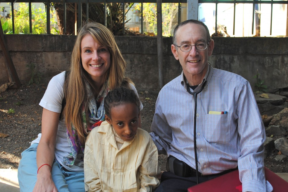 Kelli on a Mission from Ethiopia to Israel, with Sophia and Dr. Rick Hordes at his clinic. (2013)