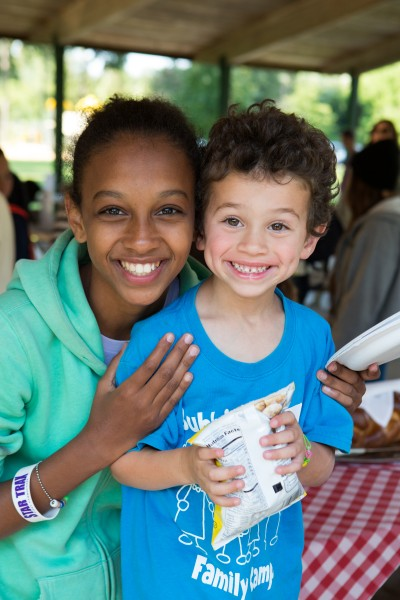 Welcome to Michigan!  Israeli campers enjoy a picnic with host families