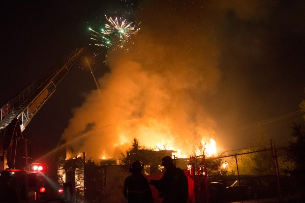 Fireworks in the night sky, and raging fires below. A devil of a night: On July 4th the Detroit Fire Department responded to 140 fires in the city. Photo: