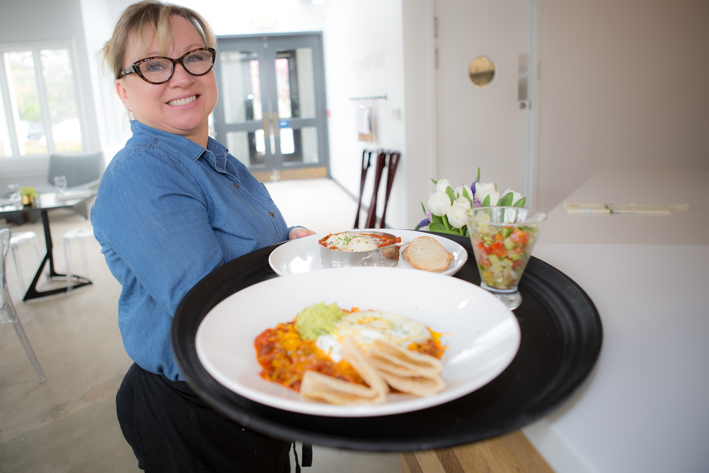 Soul Center Cafe's server, Renee McGregor, displays some of the delicious meals served at the Soul Center Café.