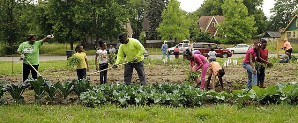 A community effort: volunteers and neighborhood residents join together to cultivate the garden. ( Photo credit: David Guralnick / The Detroit News)