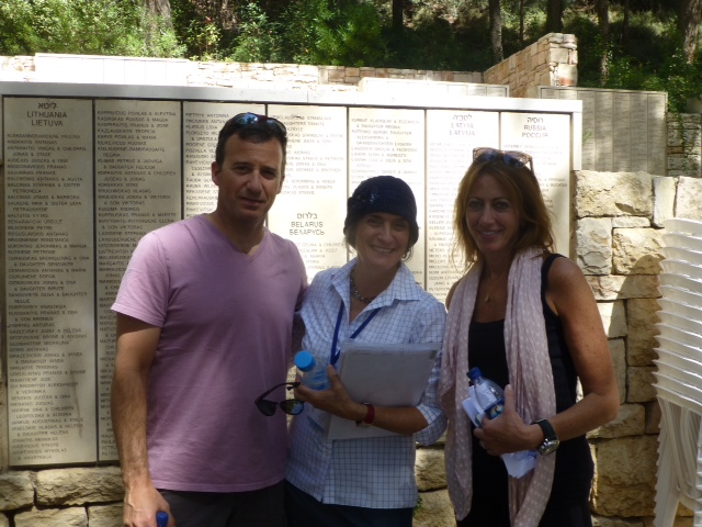 Jim Aronovitz and Carolyn Bellinson with their guide (center) at Yad Vashem
