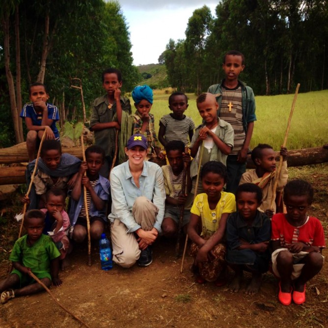 Kelli with children in Ethiopia