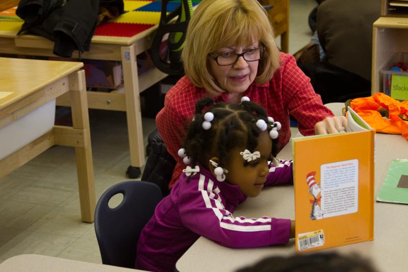 Susan Loss, Tikkun Olam Volunteer with  preschool reader at Bagley Elementary School