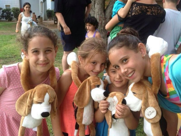 JDC's Hibuki doll program, which has been used in emergency situations since the Second Lebanon War, makes children the caretakers of a plush, sad-faced Hibuki puppy doll whose long arms can be fastened around a child, embracing them in a comforting hug.