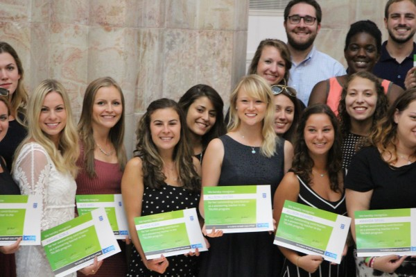 "All smiles, holding ""Certificates of Thanks,""Abby Soble (far left) with TALMA teachers."