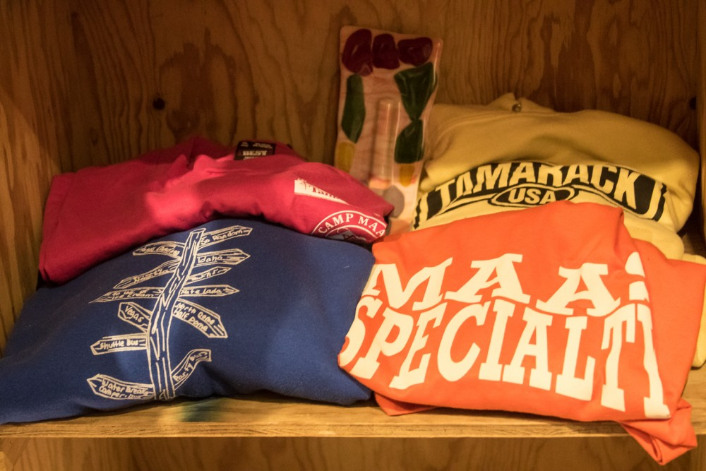 T-shirts and Tamarack memorabilia tucked away among the photos and display in the bunk area.