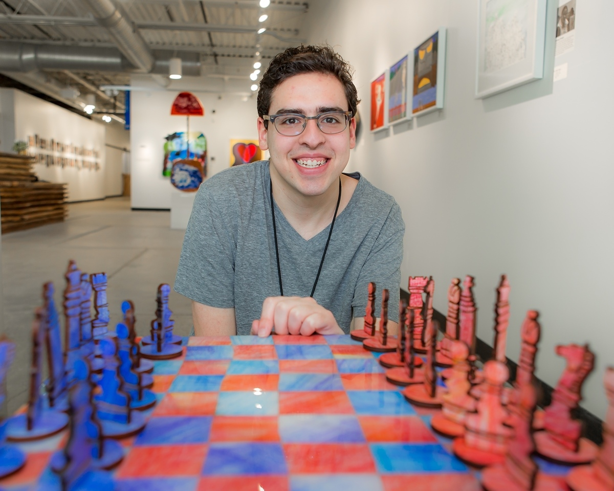 David Kole of West Bloomfield with his chess set, made at the Soul Center.